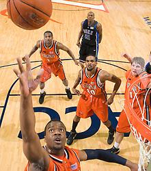 Virginia forward Jamil Tucker (12) shoots against Duke.  The Virginia Cavaliers men's basketball team faced the Duke Blue Devils at the University of Virginia's John Paul Jones Arena in Charlottesville, VA on March 5, 2008.