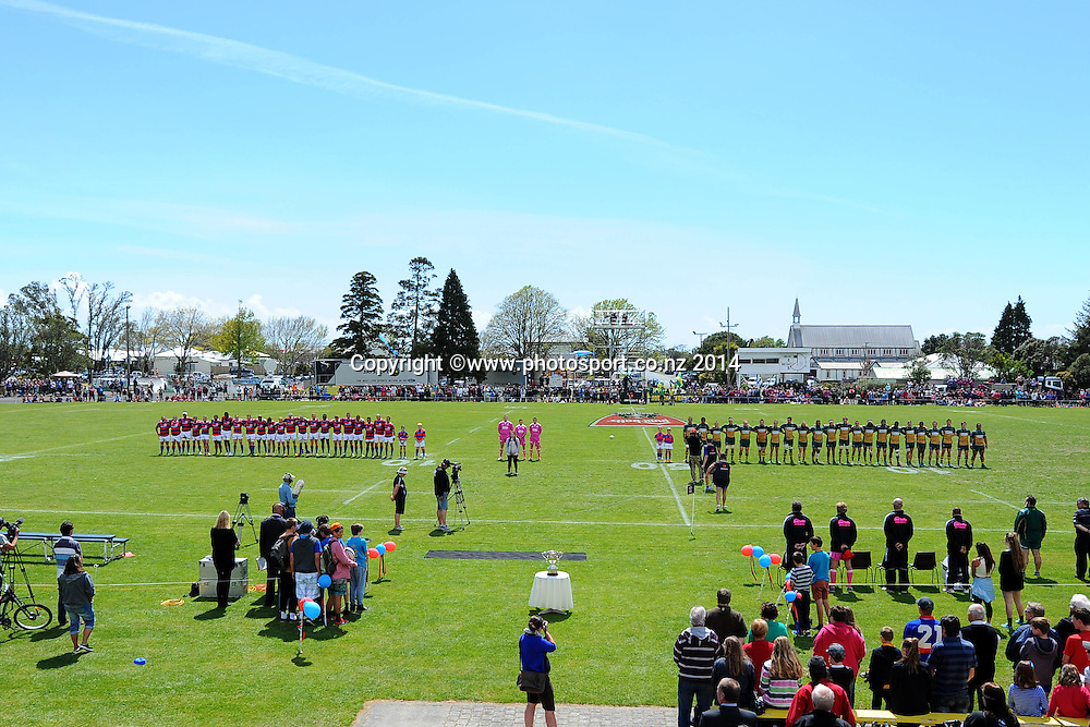 Buller and Mid-Canterbury players stand for the National Anthem during the Heartland Championship Meads Cup Final - Buller v Mid Canterbury. Victoria Square, Westport, New Zealand. Saturday 25 October 2014. Photo: Chris Symes/www.photosport.co.nz