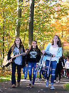 From left, Nina Kalaha, 14, Taylor Compton, 14 and  Molly Flynn, 14 all members of the Unami Middle School 9th grade chorus walk on the newly dedicated Blue Jay Trail Friday October 23, 2015 in New Britain, Pennsylvania. (Photo by William Thomas Cain)