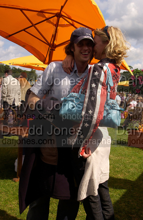 Ayden Bauer and Jodie Kidd, Veuve Clicquot gold Cup, Polo at Cowdray, 18 July 2004. SUPPLIED FOR ONE-TIME USE ONLY> DO NOT ARCHIVE. © Copyright Photograph by Dafydd Jones 66 Stockwell Park Rd. London SW9 0DA Tel 020 7733 0108 www.dafjones.com