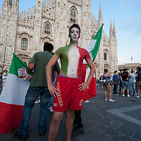 MILAN, ITALY - JUNE 14:  An Italian fan shows his chest paintedin the colours of the Italian flag in Piazza del Duomo on June 14, 2010 in Milan, Italy. Italy's national football team managed a draw 1-1 against Paraguay in their first match of FIFA 2010Soccer World Cup.