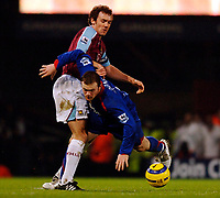 Photo: Daniel Hambury.<br /> West Ham United v Manchester United. The Barclays Premiership. 27/11/2005.<br /> West Ham's Christian Dailly and Manchester's Wayne Rooney battle for the ball.