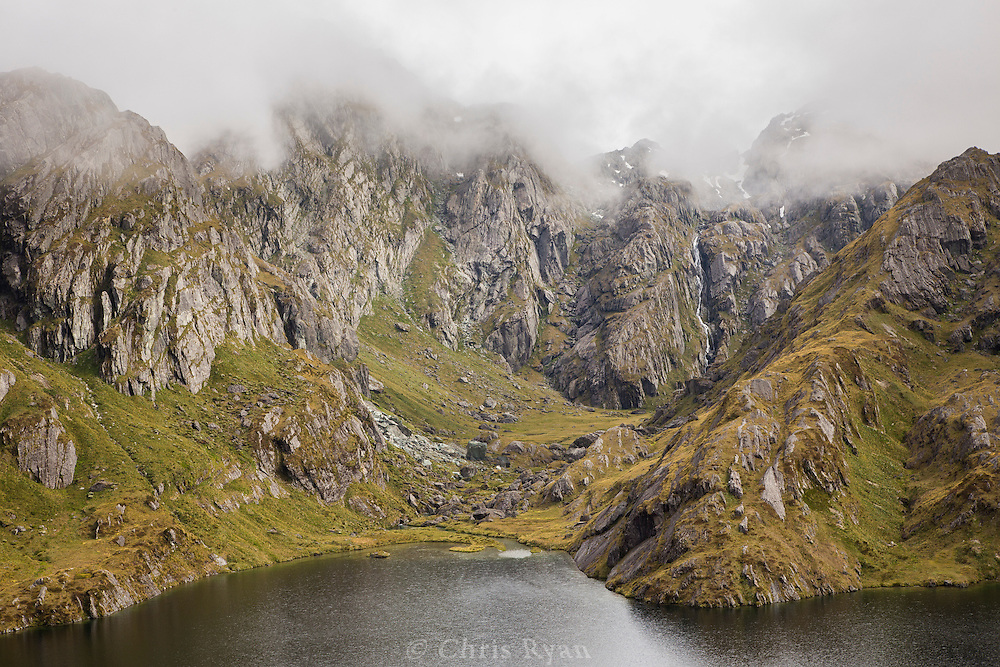 Mountain peaks shrouded in fog, Routeburn Track, South Island, New Zealand