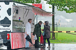 © Licensed to London News Pictures. 11/10/2019. Builth Wells, Powys, Wales, UK.  Weekly markets are not deterred as heavy rain hits the small Welsh market town of Builth Wells in Powys, UK. Photo credit: Graham M. Lawrence/LNP