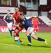 Scotland's Jason Cummings takes on FYR Macedonia's Gjoko Zajkov during Scotland Under-21 v FYR Macedonia,  UEFA Under 21 championship qualifier  at Tynecastle, Edinburgh. Photo: David Young<br /> <br />  - &copy; David Young - www.davidyoungphoto.co.uk - email: davidyoungphoto@gmail.com