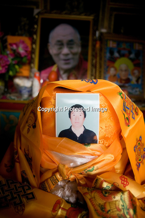 Tongren, April 3,2 012 : a picture of Sonam Dargye, 43, is seen on a family altar in Tongren county . Dargye  self-immolated in mid-March in an open street in Tongren and was cremated promptly by monks.