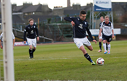 Dundee's Ryan Conroy scoring their penalty goal.<br /> Dundee 1 v 1 Falkirk, Scottish Championship game at Dundee's home ground Dens Park.