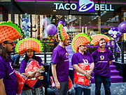 24 JANUARY 2019 - BANGKOK, THAILAND:  Americans, wearing giant foam tacos, are the first in line to visit the first Taco Bell in Thailand, which opened Thursday. The restaurant has a 215 square meter space in the Mercury Ville, a mixed use retail/office building in central Bangkok. Taco Bell is owned by Yum Brands, which also owns KFC, Pizza Hut, and WingStreet. Taco Bell in Thailand joins KFC, which has more than 500 restaurants in Thailand and Pizza Hut, which recently started expanding in Thailand.      PHOTO BY JACK KURTZ
