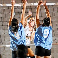 Kofa's Megan Mckenna (5) hits the ball past Erin Ridout (4) and Samantha Rangel (9) for a kill during the second game against Gila Ridge Tuesday.
