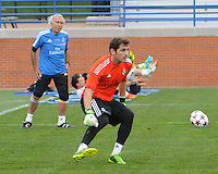 Football - Real Madrid Training for St. Louis Game against Inter Milan.  The Real Madrid team held a practice session on Thursday August 8, 2013 in St. Louis, Missouri, USA at the Robert Hermann Stadium located on the campus of St. Louis University in St. Louis.  Here, goalkeeper coach William Vecchi (left) watches goalkeeper Iker Casillas during a drill.