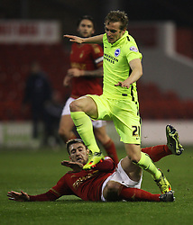 Gary Gardner of Nottingham Forest (L) fouls James Wilson of Brighton & Hove Albion - Mandatory by-line: Jack Phillips/JMP - 11/04/2016 - FOOTBALL - City Ground - Nottingham, England - Nottingham Forest v Brighton and Hove Albion - Sky Bet Championship