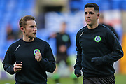Forest Green Rovers George Williams(11) and Forest Green Rovers Lloyd James(4) warming up during the EFL Sky Bet League 2 play off first leg match between Tranmere Rovers and Forest Green Rovers at Prenton Park, Birkenhead, England on 10 May 2019.