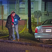 Investigators look over the scene of a shooting on Veterans Boulevard in Brundidge, Ala., early Saturday, Dec. 27, 2014. One person was killed at the scene, and others were transported to a local hospital. (Photo/Thomas Graning)