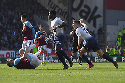 Burnley's Chris Wood clashes with Tottenham Hotspur's Juan Foyth (right)