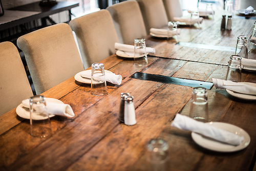 A simple table setting in a restaurant on a solid wooden table. & Rustic Restaurant Interior Design Table | Have Camera Will Travel ...