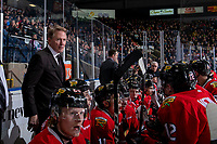 KELOWNA, BC - MARCH 02:  Portland Winterhawks' head coach Mike Johnston stands on the bench against the Kelowna Rockets  at Prospera Place on March 2, 2019 in Kelowna, Canada. (Photo by Marissa Baecker/Getty Images)