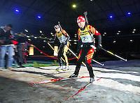 BIATHLON / World Team Challenge in der Gelsenkirchen Arena  Die Laeufer Andrea Henkel (re) und Frank Luck (li) auf der Loipe in der Arena, Allgemein