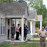 Area residents, city officials and members with NDC, tour some of the remodeled homes on West Jackson Street in Tupelo during a redevelopment ground breaking and tour Monday morning.
