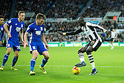 Newcastle United midfielder Mohamed Diame (#15) enters the box and takes on Birmingham City midfielder Stephen Gleeson (#8) during the EFL Sky Bet Championship match between Newcastle United and Birmingham City at St. James's Park, Newcastle, England on 10 December 2016. Photo by Craig Doyle.