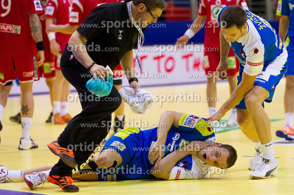 Uros Zorman of Slovenia injured during handball match between Norway and Slovenia in Preliminary Round of 10th EHF European Handball Championship Serbia 2012, on January 16, 2012 in Millennium Center, Vrsac, Serbia. Norway defeated Slovenia 29-28. (Photo By Vid Ponikvar / Sportida.com)