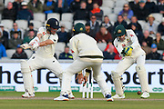 Rory Burns of England edges the ball through the legs of Tim Paine of Australia during the International Test Match 2019, fourth test, day two match between England and Australia at Old Trafford, Manchester, England on 5 September 2019.