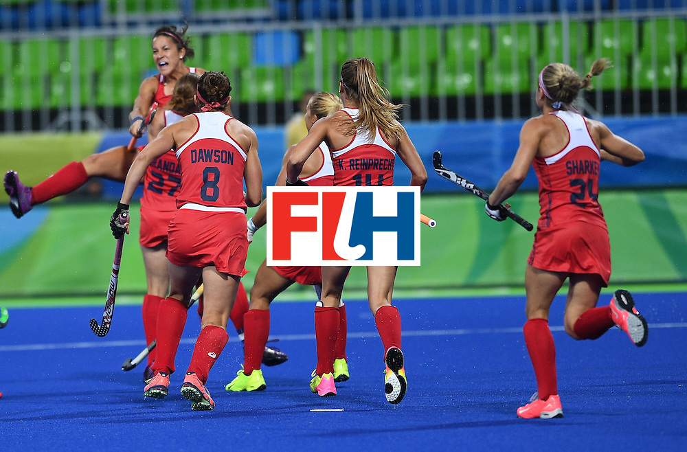 USA team members celebrate a goal during the women's field hockey USA vs Japan match of the Rio 2016 Olympics Games at the Olympic Hockey Centre in Rio de Janeiro on August, 10 2016. / AFP / MANAN VATSYAYANA        (Photo credit should read MANAN VATSYAYANA/AFP/Getty Images)