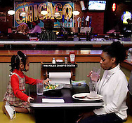 "Angela, 2, and Zari Lawrence, stopped in at Uno's to, ""try something different,"" Saturday night, March 17th."