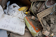 Personal items such as school books are scattered throughout the debris of destroyed houses in Ishinomaki city in Miyagi prefecture, Japan Friday May 6th 2011. Ishinomaki bore the brunt of the magnitude 9 earthquake that struck the Tohoku coast on March 11th and the town was almost completely destroyed by the large tsunami that followed the quake 20 minutes later