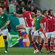 Man of the match Mike Phillips, Wales, (centre) celebrates the welsh win as the final whistle sounds during the Ireland V Wales Quarter Final match at the IRB Rugby World Cup tournament. Wellington Regional Stadium, Wellington, New Zealand, 8th October 2011. Photo Tim Clayton...