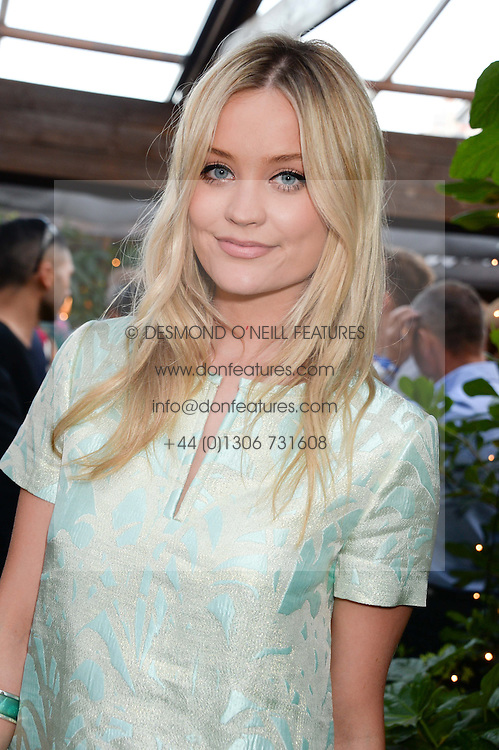 LAURA WHITMORE attending the Warner Bros. & Esquire Summer Party held at Shoreditch House, Ebor Street, London E1 on 18th July 2013.