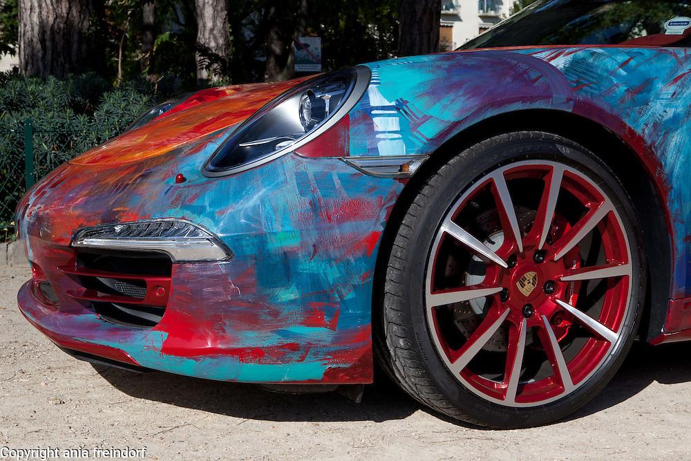 "Saudi artist Shalimar Sharbatly, ""Shalemar"", her art, painting on a Porsche car, Paris, France."