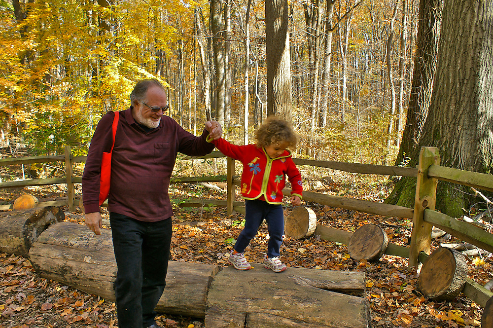 Active Aging Senior Citizens, Retired, Activities, Grandfather and Grandchild Walk in Woods, Fall Family Camping PA State Park, Hiking, Codorus State Park, PA