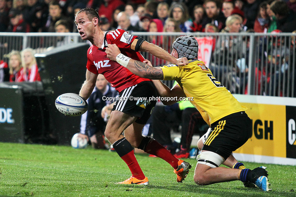 Andy Ellis of the Crusaders looks for the offload in the tackle of Blade Thompson of the Hurricanes during the Investec Super Rugby between Crusaders v Hurricanes at AMI Stadium, Christchurch. 28 March 2014 Photo: Joseph Johnson/www.photosport.co.nz