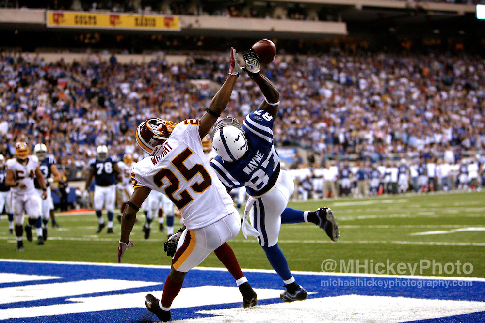 WireImage #11023233--Indianapolis wide receiver Reggie Wayne battles with Washington's Kenny Wright for a pass in the end zone at the RCA Dome in Indianapolis, Indiana on October 22, 2006. The Colts defeated the Redskins 36-22.