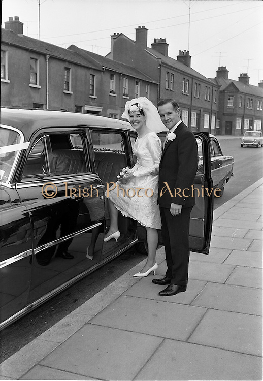 28/07/1962<br /> 07/28/1962<br /> 28 July 1962 <br /> Wedding of Mr Desmond F. English, Landscape Cresent, Churchtown and Miss Blanche O'Brien Oakley Park, Blackrock at St John the Baptist Church, Blackrock and Ross's Hotel Dun Laoghaire, Dublin. Image shows the bride and groom getting into the wedding car after the ceremony.