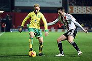 Norwich City forward Alex Pritchard (21) battles for possession with Brentford defender Tom Field (30) during the EFL Sky Bet Championship match between Brentford and Norwich City at Griffin Park, London, England on 31 December 2016. Photo by Matthew Redman.