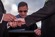 Photo by Matt Roth<br /> Assignment ID: 30148071A<br /> <br /> David Hagedorn, left, puts a wedding band on Michael Widomski's finger. Supreme Court Justice Ruth Bader Ginsburg married the couple at Fiola Restaurant's rooftop area in Washington, DC, Sunday, September 22, 2013. This was Ginsberg's second stint as a same sex wedding officiant since DOMA was overturned.