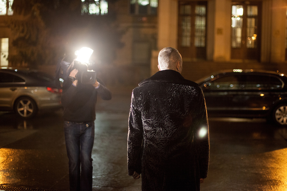 """Prof. Vladimír Franz waitung for his """"Air Franz One"""" car after a discussion with all Czech presidential candidates at the National Technical Library in Prague Dejvice. Franz is a prominent Czech composer and painter, stage music author and also a registered candidate in the 2013 Czech presidential election."""