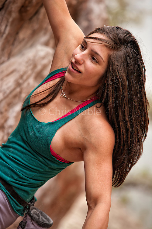 Professional Bouldering competitor Alex Puccio bouldering on Flagstaff Mountain near Boulder Colorado.