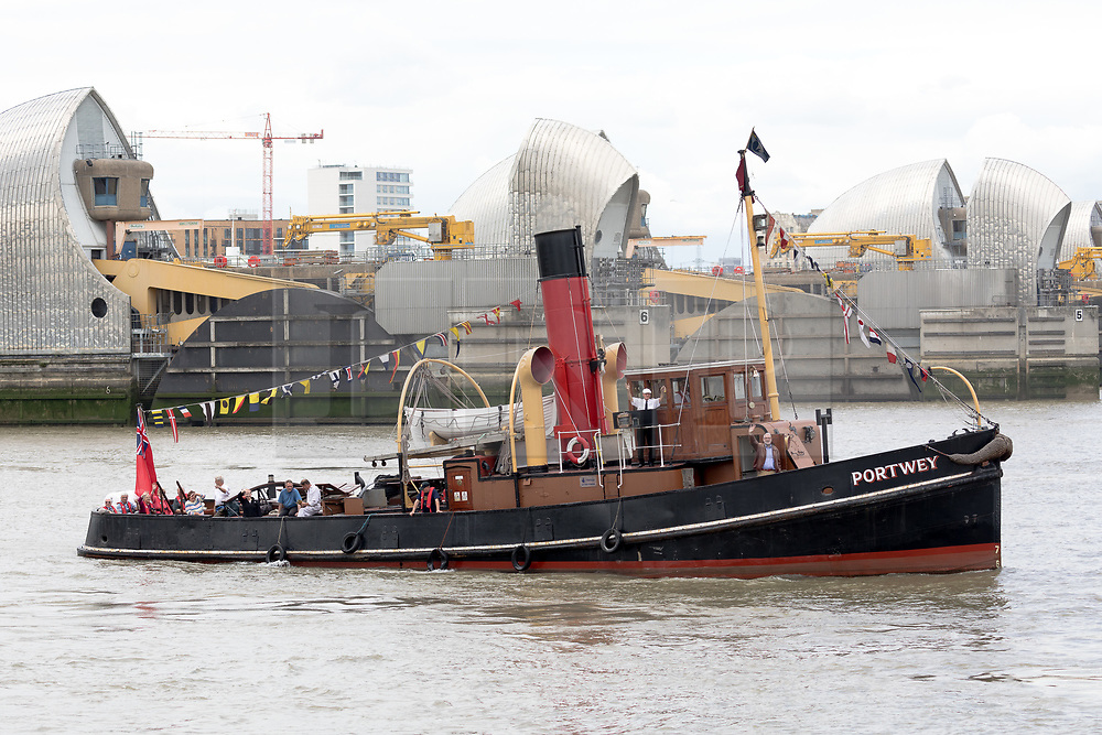 © Licensed to London News Pictures. 04/08/2017. LONDON, UK.  Steam Tug (ST) Portwey steams along the River Thames through the Thames Barrier in London, travelling to Gravesend to take part in a series of events marking her 90th birthday, including a salute by Commander Richard Pethybridge at the Royal Navy's HMS President on the way. The ST Portwey was built on the Clyde in 1927, came under the command of the Royal Navy during the Second World War when she was based in Dartmouth and carried out rescues of vessels and crews sunk by enemy action in the Channel and is the only twin screw, coal fired steam tug still active in the whole of the United Kingdom.  Photo credit: Vickie Flores/LNP