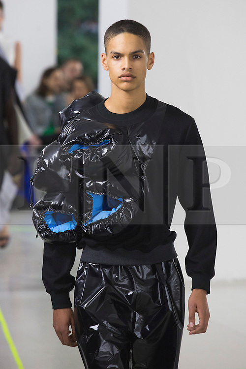 © Licensed to London News Pictures. 03/06/2015. London, UK. Collection by Jae Hyuk Lim. A model walks the runway at the Royal College of Art (RCA) MA Fashion graduate fashion show.  Photo credit : Bettina Strenske/LNP