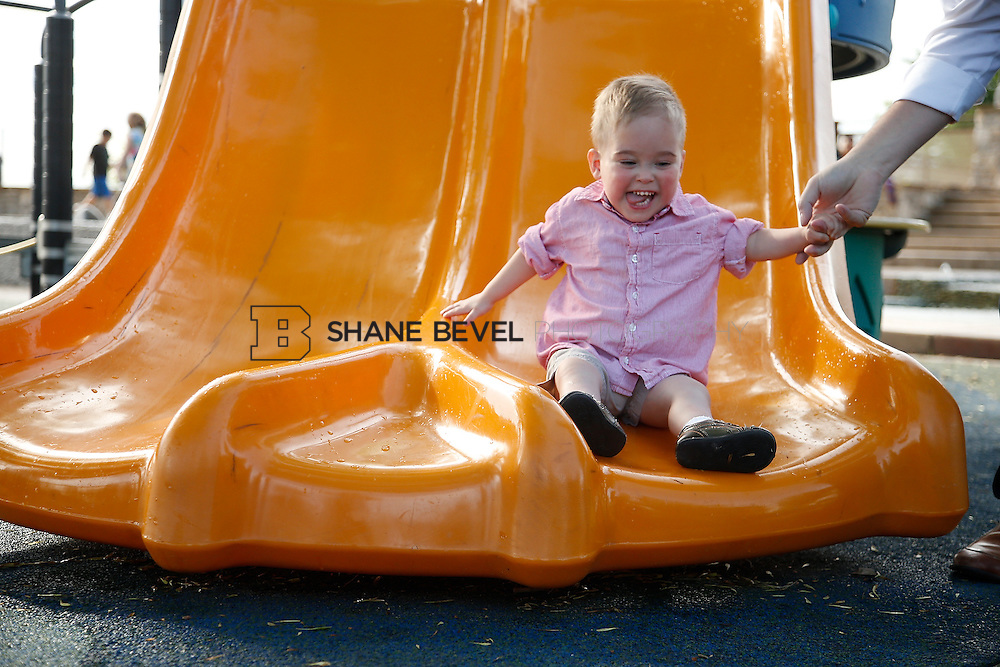 5/28/15 6:05:08 PM -- Miracle Miles and his family pose for portraits and play at the QuikTrip park for the 2015 Saint Francis Health System advertising campaign. <br /> <br /> Photo by Shane Bevel