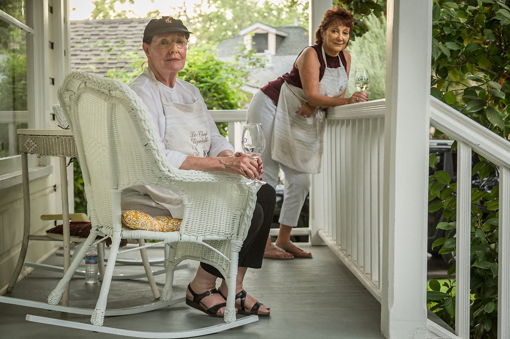 """Dinner's in the oven and we're enjoying a pre-dinner glass of wine on the porch.""  -Liz McNally and her house guest, Maria Marti, enjoy a warm evening in Calistoga."