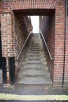 Steps through brick wall at London; England; UK