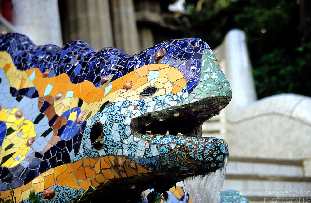 Antoni Gaudi's Park Guell is a UNESCO World Heritage Site. Gaudí's multicolored mosaic dragon fountain guards the entrance to Park Guell in Barcelona, Spain