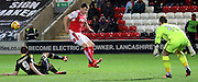 Morecambe Striker Tom Barkhuizen defends during the Johnstone's Paint Trophy match between Fleetwood Town and Morecambe at the Highbury Stadium, Fleetwood, England on 8 December 2015. Photo by Pete Burns.