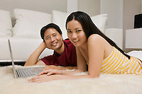 Couple on Rug with Laptop