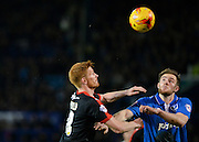 Crawley Town Striker Matt Harrold and Portsmouth defender Matt Clarke challenge for the ball during the Sky Bet League 2 match between Portsmouth and Crawley Town at Fratton Park, Portsmouth, England on 2 January 2016. Photo by Adam Rivers.
