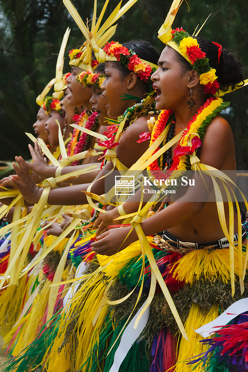 Yapese girls in traditional clothing singing and dancing at Yap Day Festival, Yap Island, Federated States of Micronesia