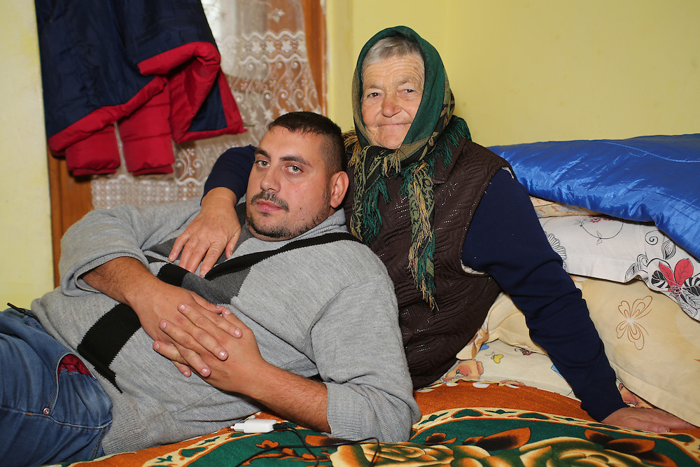 Razvan in his bedroom with his grand-mother on his dad's side.